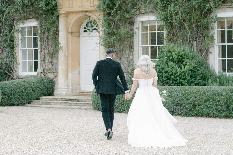 Weddings in 2021 - Bride and groom outside their venue - elegant wedding planner surrey