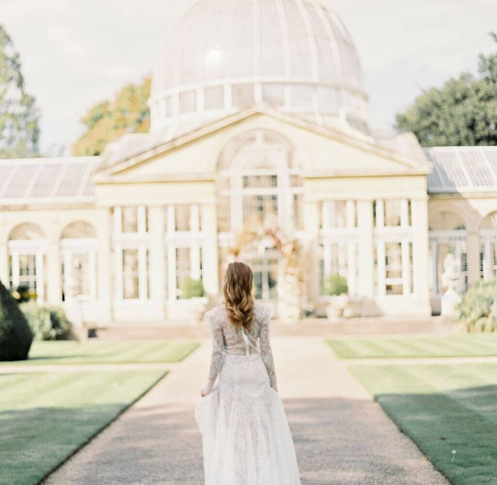Bride outsite her beautiful wedding venue - parties celebrations surrey