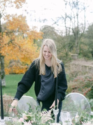Amie dressing the wedding table in the garden