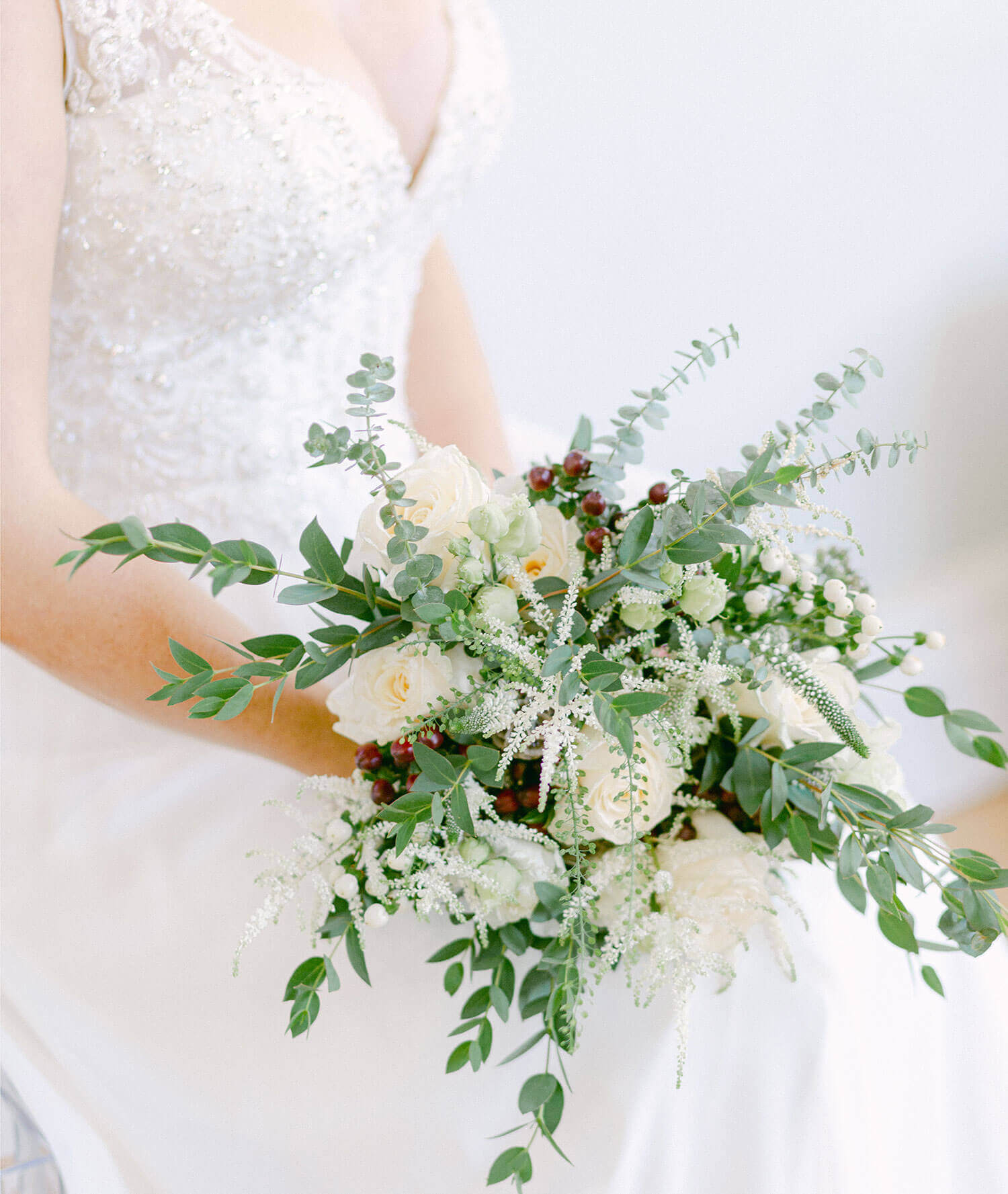 Bride holding bouquet - elegant wedding planner surrey