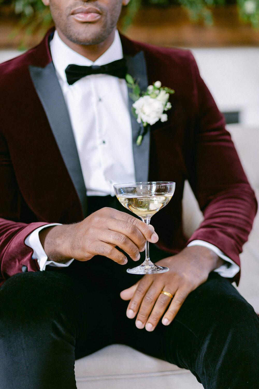 Groom holding a glass of champagne - elegant wedding planner surrey