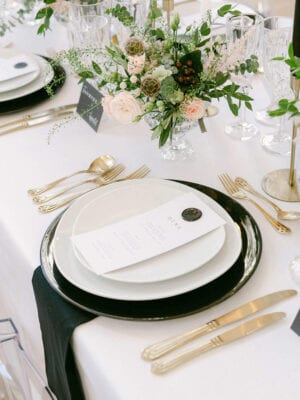 Wedding table set with menu and golden utencils