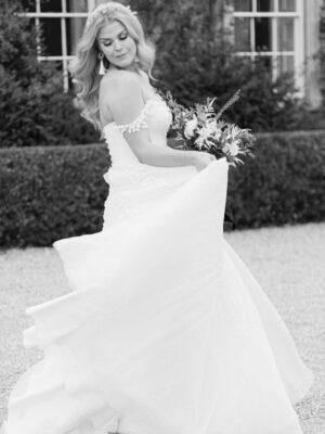 Bride dancing at Cornwell Manor wedding and events venue - elegant wedding planner surrey