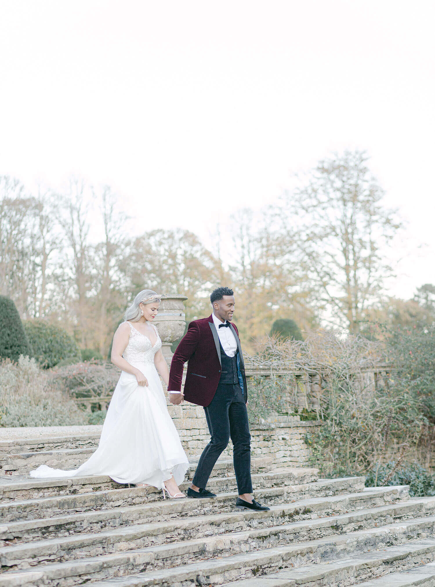 Wedding couple walking down stairs - Wedding planner surrey