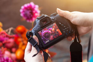A person taking photos with a camera, Amie Jackson loves photography - elegant wedding planner surrey