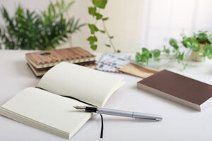 A blank notebook and pen representing Amie Jackson's love of stationery - modern wedding planner surrey