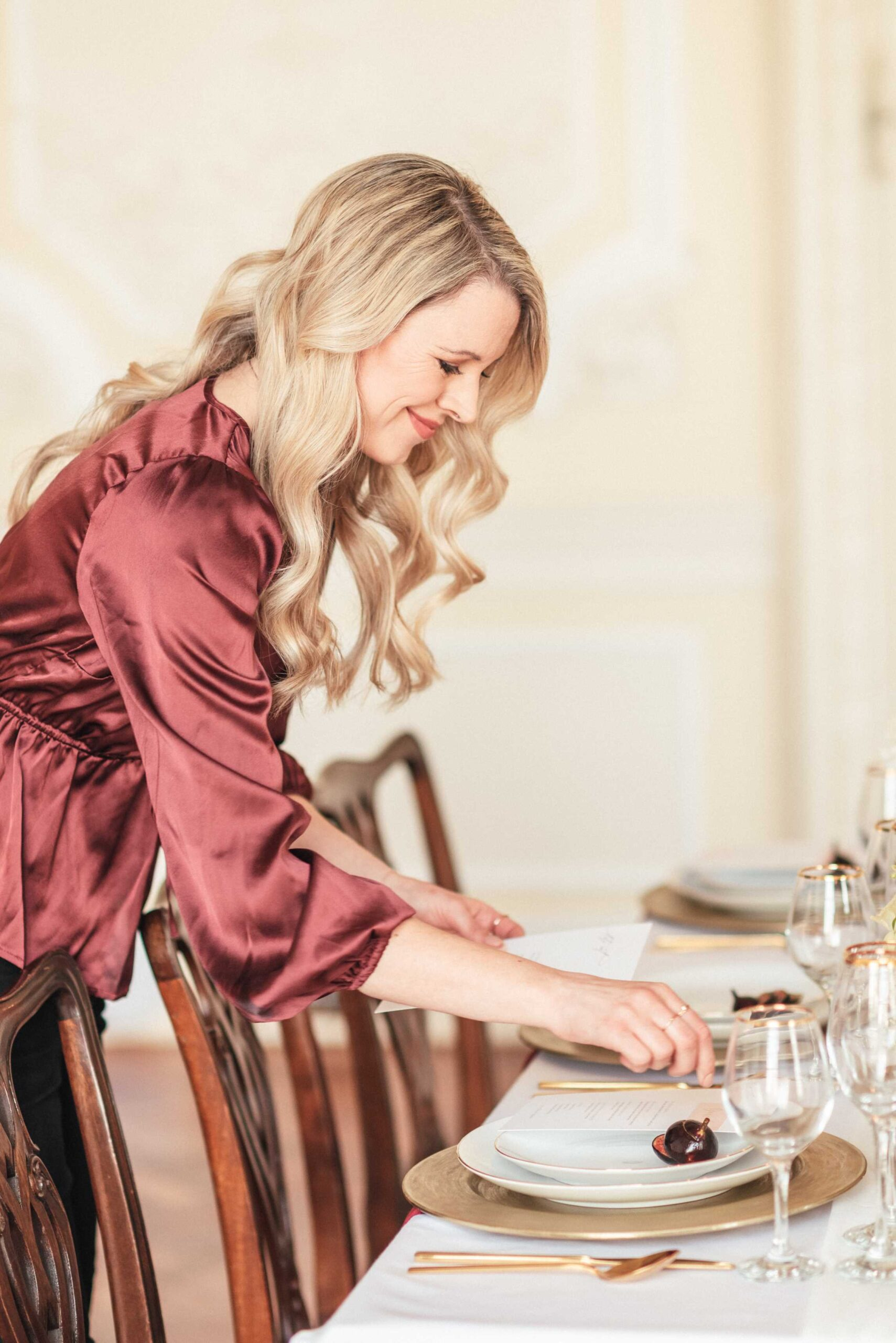 Wedding and event planner, Amie, styling a wedding tablescape.
